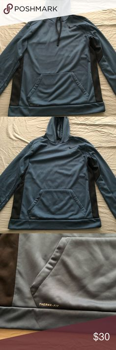 Nike hoodie Blue with black Size L Therma fit  In perfect condition  Only worn once Has been sitting in my closet Nike Sweaters