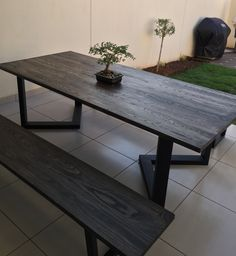 10 seater, American ash table top treated with charcoal mono coat mounted on a black ferrograin powder coated steal base. Hand made in Johannesburg, South Africa by the Create Space team.