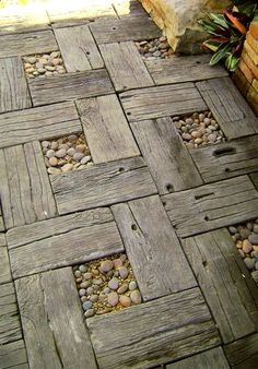 Reclaimed wood with stones garden walkway design - or this design idea could be used to make a rustic looking outdoor patio table.