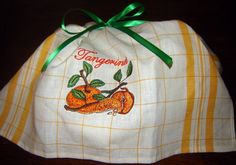 Gift bag sewn with washaway thread.  After serving its purpose as a bag, it reverts to its original form, a dishtowel.