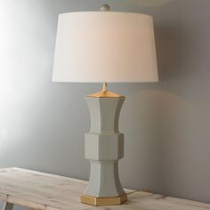 """The contemporary design of this hexagon-shaped table lamp will fit right in with tradtional or contemporary designs for a classic look. Gold accents and retro drum  off white drum shade. 150W max, 3-way medium base socket. (27.5""""Hx16""""W) Unique Table Lamps, Grey Table Lamps, Table Lamp Shades, Lamp Table, Carriage Lights, Bedside Desk Lamps, Transitional Style, Transitional Bedroom, Drum Shade"""