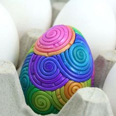 Polymer Clay Easter egg.  I've done a little work with polymer clay and this took some time to create, bake, sand, polish and seal.  So pretty.