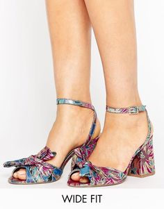 Get this Asos's heeled sandals now! Click for more details. Worldwide shipping. ASOS HUMBUG Wide Fit Bow Sandals - Multi: Sandals by ASOS Collection, Textile upper, Ankle-strap fastening, Open toe, Knot design, Block high heel, Wide fit, Wipe with a damp cloth, 100% Textile Upper, Heel height: 8.5cm cm/3.5. Score a wardrobe win no matter the dress code with our ASOS Collection own-label collection. From polished prom to the after party, our London-based design team scour the globe to nail…
