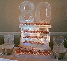 I love this 80th birthday ice sculpture and how the party hosts used it to keep shrimp cool.