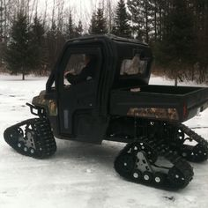 Polaris Ranger with tracks ready for snow! I want these so bad! Apparently bad for you bearings though! I'd still try a pair out to be honest! Mountain Lion Hunting, Polaris Off Road, Utv Accessories, Polaris General, Luxury Rv, Bug Out Vehicle, Ski Gear, 4 Wheelers, Polaris Ranger