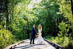 Beautiful bride and groom on foot bridge at Saratoga National wedding in Saratoga Springs, NY