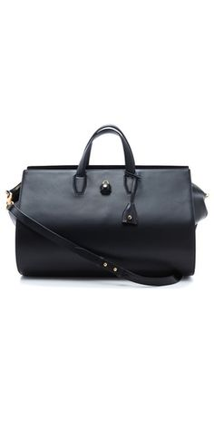 """Alexander Wang Pelican Weekender  """"FREE SHIPPING at shopbop.com. The generous size of this sleek leather Alexander Wang handbag is balanced by delicate design details. A dainty key hides inside the pouch hanging from the handles, and can be used to lock the small polished padlock to the slotted two-way zip pulls."""