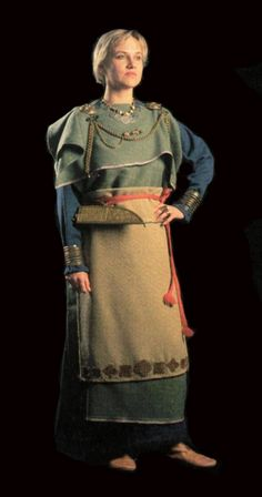 Female dress. Finland. Reconstructed from archaeological finds. The brooches at each shoulder seem to be Viking tortoise design as is the coin laden necklace, so I'm not sure how accurate this is for the Iron Age