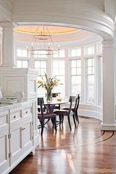 Traditional Dining Room with Crown molding, Built-in bookshelf, Columns, Dura Supreme Cabinetry Breckenridge Panel