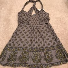 NWT Free People grey henna print boho tank top Boho vibe Free People grey tank top in size Xsmall. Gorgeous henna and floral print in grey and soft yellow. Twisted x back bandeau front that's super soft and stretchy. Never worn with tag attached. Sorry no PayPal or trades. Free People Tops Tank Tops