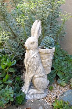 Add a touch of whimsy to your outdoor space with a character of choice from HomeGoods! This rabbit also doubles as an elevated planter, so cute!