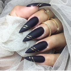 Stiletto black and gold nail design