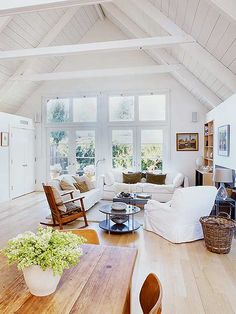 white living room with a high peaked ceiling