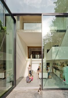 Pivoting #window entrance of a beautiful #modern home with a minimal interior and #vintage appliances