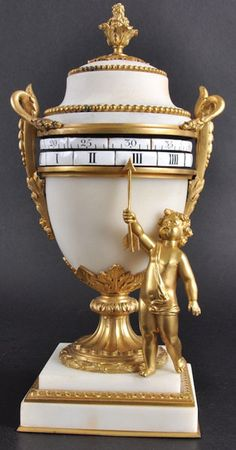 A GOOD 19TH CENTURY FRENCH ORMOLU AND MARBLE URN SHAPED MANTLE CLOCK with revolving enamel dial, the hands formed by a standing cupid with arrow. 11ins high.