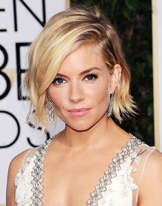 What's better than a bob? A ruffled bob, obviously. Light layers and feathered ends, as well as a slight asymmetrical angle, make this short cut an easy one to tousle and volumize. Thanks...