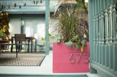 Easy Curb Appeal Project: Wood Planter Box With House Numbers. >>http://www.diynetwork.com/how-to/make-and-decorate/decorating/how-to-make-a-wood-planter-box-with-house-numbers?soc=pinterest