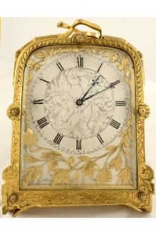 Antique gilt strut clock in the manner of Thomas Cole