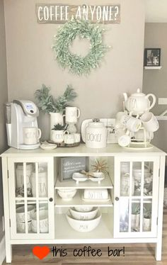 Put THIS coffee bar in MY kitchen NOW!  Love this coffee nook setup and all the gorgeous Rae Dunn coffee canisters and mugs!  That farmhouse cabinet is the perfect coffee station area, isn't it?  Just love it ALL!  #DreamHome #diyhomedecor #coffeebar #coffeenook #raedunn #farmhouse #FarmhouseKitchen