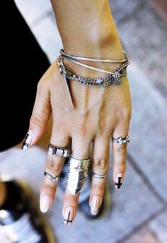Crosses + knuckle rings.
