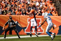 Emmanuel Sanders (10) of the Denver Broncos stretches to make a catch as Rashaan Melvin (30) of the Indianapolis Colts defends during the first quarter. The Denver Broncos hosted the Indianapolis Colts on Sunday, September 18, 2016. Joe Amon, The Denver Post