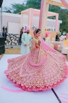 Love this Indian brides rose pink Rimple and Harpreet wedding lehenga. Wedding Lehenga Designs, Designer Bridal Lehenga, Indian Bridal Lehenga, Indian Bridal Outfits, Indian Bridal Fashion, Indian Bridal Wear, Best Indian Wedding Dresses, Indian Bride Dresses, Pink Bridal Lehenga