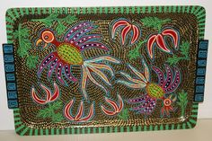 Artist Signed Unique Intricate Detail Handpainted Wood Huichol Serving Tray Artist Signed Unique Intricate Detail Handpainted Wood Huichol Serving Tray ... One of A kind signed Art by Dominique Rice: (Colorful mola and huichol inspired patterns)