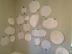arranging plates on a wall. make paper measurements to see first