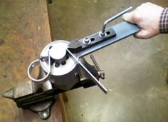 """Homemade compact radial bender fabricated from steel. Capable of bending 1"""" flat stock of up to 1/4"""" thickness. Accommodates nine mandrels allowing for a range of achievable bend radii from 1/4"""" to 1""""."""