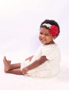 This is a handmade Flower headband the flower is attached to lace elastic!!This would be perfect for newborn photo shoots,birthday parties,flower