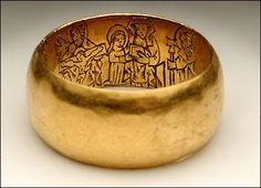Agold Ring from Medieval London 1400s. It's decorated with engraved figures of St Thomas Becket and other Christian figures which were meant to protect the ring's owner from harm.