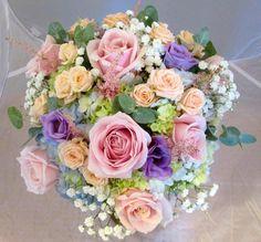 Lovely Round Pastel Wedding Bouquet: Sky Blue Hydrangea, Mint Hydrangea, Pink Roses, Lavender Lisianthus, Peach Spray Roses, White Gypsophila (Baby's Breath), Baby Blue Eucalyptus