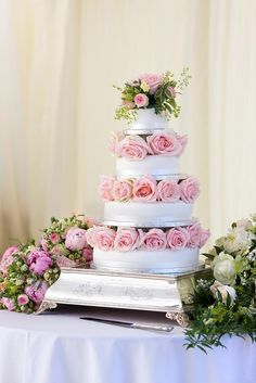 Soft pink roses between the tiers of the cake