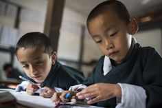 Local school children are busy learning in the classroom in Bhutan. Image: Conor_Ashleigh_-®2014