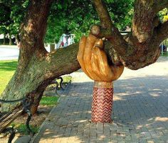 The 'Helping Hand', which holds up the old tree nicknamed 'Wonky Conker', was sculpted by John Butler. The old tree was nearly chopped down for a carpark, but saved by townspeople of Bideford, UK.
