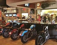 WOW a man cave bar with motorcycles for seats. That's pretty cool.