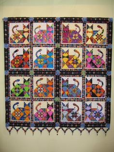 """Love and Dream"" cat quilt, with yo yo sashing and a cathedral windows border. Spotted at the 2007 Tokyo International Quilt Festival. Photo by Oregon quilt."