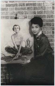This is Lady Bird Cleveland, mother of legendary model Pat Cleveland photographed by Carl Van Vechten on November 16, 1954 with her painting in oil of Eartha Kitt. Now known as Lady Bird Strickland, she is still painting today. She told the Philadelphia Inquirer in 2013 that her calling is; to paint black history from the heart. By Nichelle Gainer