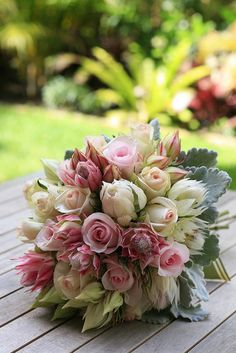 Jenna, I don't know what you are thinking about for flowers, but these are beautiful!  Roses and Blushing Bride flowers with some Dusty Miller foliage