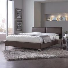 The sleek, contemporary design of the Aurora Platform Bed features a rich Greige color faux leather upholstery that enhances any room's decor. The two headboard cushions are adjustable, providing excellent seating comfort for working, watching TV, reading, or just relaxing in bed. They are easily attached or removed with Velcro attachments.