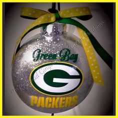 A personal favorite from my Etsy shop https://www.etsy.com/listing/260475583/green-bay-packers-ornament