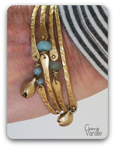 pretty bangles--like the way she uses a drawn bead at end of the wire as a rivet--We need to try that on Workshop 1st Wednesday
