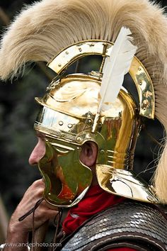 Roman reenactor Optio. He wears a helmet with two feathers and a crest is one of the symbols that he is an Optio, or a deputy for the Centurion