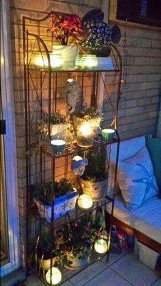 Like the use of the baker's rack. Could make the battery lights with the old light globes (small ones). Would need to get anti-mosquito plants.
