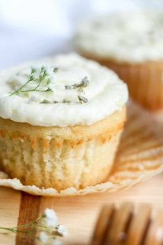 Light and airy vanilla cupcakes made with real vanilla bean and lavender underneath a layer of almond and honey buttercream.