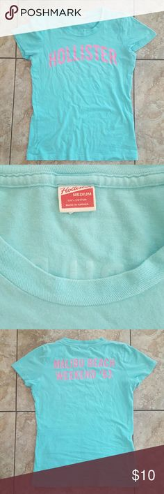 Hollister Malibu Beach tee Really cute light turquoise tee with pink logo on front and graphic on back. Slight wear as was gently used. 100% cotton.   A bummer to re-posh 🌷. I may never learn a medium in the Hollister world is SMALL! Hollister Tops Tees - Short Sleeve