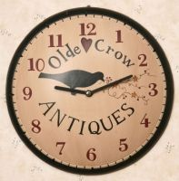 """Country Primitive Crow Antiques Wall Clock - Country Primitive Crow Antiques Wall Clock 11 1/4"""" dia. Wood Requires 1 AA Battery. Popular themes of country clocks include farm animals; rustic finishes Country themed clocks make one of the best accessories for any room."""