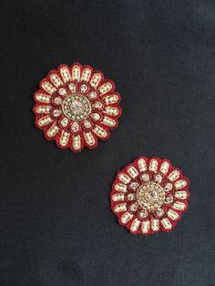 Elegant round Maroon handmade applique, in a floral motif, embellished with white CZ stones of different sizes and white beads, embroidered with golden Zari thread to bring out a beautiful contrast. This kind of beads and stone work is very popular in the Rajasthani Moti Bharat embroidery.  Price indicated is for a pair (2 pieces). You could use this applique in various ways, such as - - embellishing your dress - in styling handbags - making wine bottle art - to decorate cushions…
