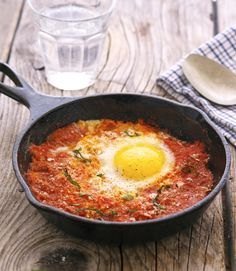 Eggs Poached In Marinara Sauce - marinara sauce (includes recipe link if you want to make homemade), cayenne pepper (optional), eggs, salt, ground pepper, garnishes (grated Parmesan + fresh basil OR avocado/guacamole)