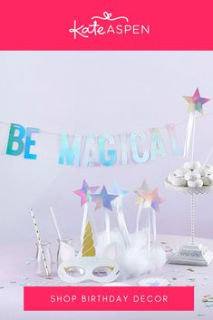 Filled with everything you need to transform an ordinary party to a magical, unforgettable experience—including iridescent star wands, unicorn face masks, coasters and straws. There is no way your guests will not be enchanted. | Enchanted Unicorn 49 Piece Party Décor Kit | Kate Aspen